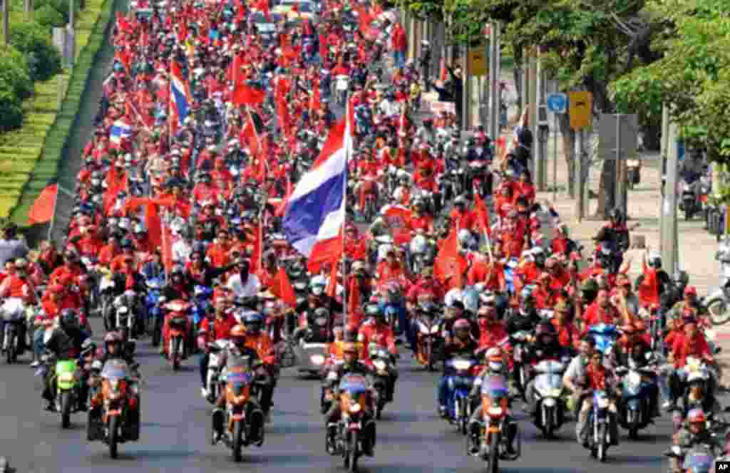 Supporters of deposed Thai premier Thaksin Shinawatra ride motorcycles while parading during a protest in Bangkok on March 15, 2010.