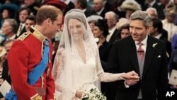 Prince William greets Kate Middleton as she arrives at the alter with her father Michael Middleton, prior to their marriage in London's Westminster Abbey, Friday April 29 2011.(AP Photo/ Dominic Lipinski, pool)
