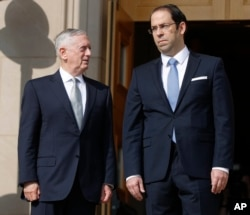 Defense Secretary Jim Mattis, left, hosted an enhanced honor cordon for Tunisian Prime Minister Youssef Chahed at the Pentagon, July 10, 2017.