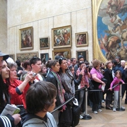 "Visitors looking at the ""Mona Lisa"""