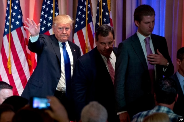 Republican presidential candidate Donald Trump, accompanied by New Jersey Gov. Chris Christie, center, and his son Eric Trump, right, depart after speaking during a news conference on Super Tuesday primary election night in the White and Gold Ballroom at