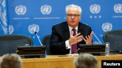 FILE - Vitaly Churkin, Russia's ambassador to the United Nations, speaks during a news conference at U.N. headquarters in New York.