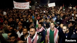 Protesters shout slogans during a protest in Amman, Jordan, June 4, 2018.