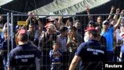 Migranti iz Sirije u izbegličkom kampu Roske u Mađarskoj, 28. avgusta 2015.