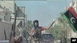 Моамер Гадафи погребан на тајна локација