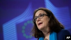 FILE: European Trade Commissioner Cecilia Malmstrom talks to journalists during a news conference at the European Commission headquarters in Brussels, Monday, April 15, 2019. (AP Photo/Francisco Seco)