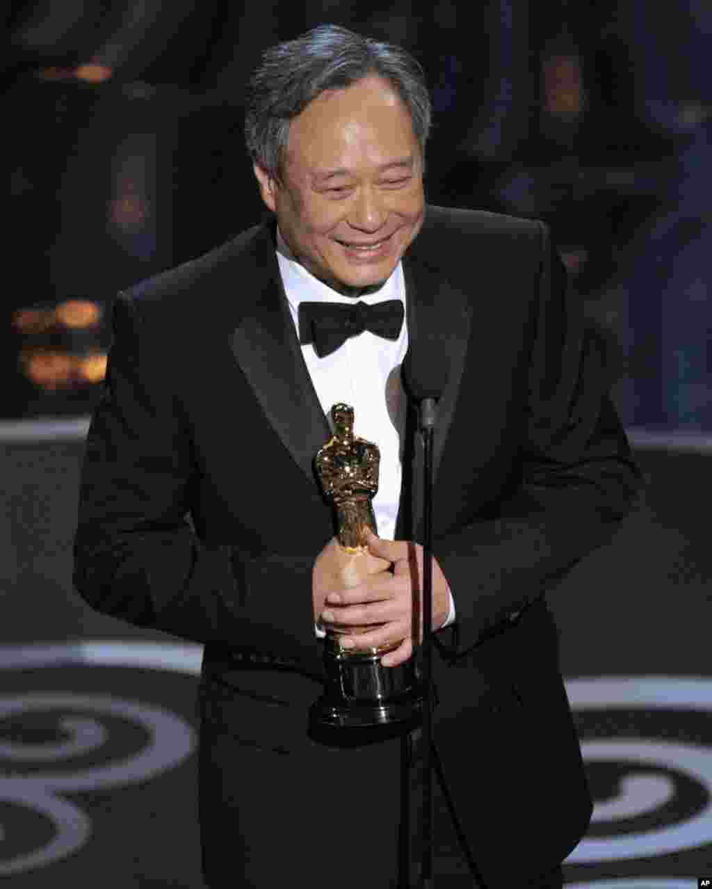 "Ang Lee accepts the award for best directing for ""Life of Pi""."