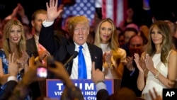 FILE - Republican presidential candidate Donald Trump is joined by his wife Melania, right, and daughter Ivanka, left, as he speaks during a primary night news conference, May 3, 2016.
