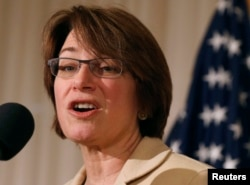 "FILE - U.S. Sen. Amy Klobuchar, D-Minn., pictured at the National Press Club in Washington, Jan. 8, 2015, says that ""even if the Russian interference hadn't occurred [in the 2016 election], we should still be updating our laws."""