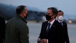 U.S. Secretary of State Antony Blinken talks with Lieutenant General Scott Pleus, the deputy commander of United States Forces Korea, before he boards a plane at the Osan Air Base in Pyeongtaek, South Korea, Thursday, March 18, 2021