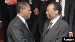 Ivory Coast President Alassane Ouattara (L) greets Dioncounda Traore, Acting President of Mali, after an extraordinary summit of West African regional bloc ECOWAS on the crisis in Mali, Abidjan, January 19, 2013.