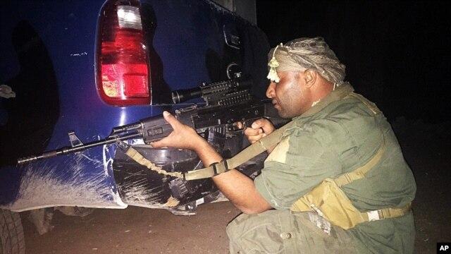 An Iraqi Sunni tribal fighter in Ramadi, the capital of Anbar province, 115 kilometers (70 miles) west of Baghdad, Iraq, early Saturday, May 16, 2015.