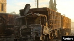 Ayarin motoci dauke da kayan agaji a kan hanyarsu ta zuwa birnin Aleppo da aka kaiwa hari cikin Siriya