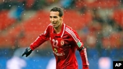 FILE - Mohamed Aboutrika celebrates after scoring a goal during a quarterfinal at the FIFA Club World Cup soccer tournament in Japan, Dec. 9, 2012.