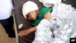 This image made from video taken Aug. 9, 2018, shows a child injured in an airstrike resting at a hospital in Saada, Yemen.