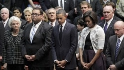President Obama and his wife, Michelle, at the memorial service. Next to the president is Daniel Hernandez, 20, an intern who rushed to the aid of Rep. Gabrielle Giffords. Next to the first lady is the congresswoman's husband, NASA astronaut Mark Kelly.
