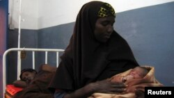 Somali woman holds a newly born baby. (file)
