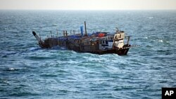 In this photo provided by the U.S. Navy, the Iran-flagged, Ya-Hussayn, takes on water in the Persian Gulf, January 10, 2012.