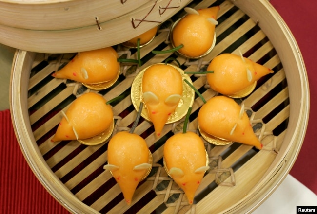 FILE - New Year radish cakes made in the shape of mice for the Lunar Year of the Rat in 2008. REUTERS/Bobby Yip