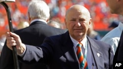 Former Miami Dolphins owner, Wayne Huizenga stands on the field before an NFL football game between the Miami Dolphins and New York Jets, Jan. 1, 2012, in Miami.