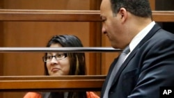FILE - Alejandra Guerrero (L) appears in Los Angeles Superior Court, Jan. 12, 2015 with her attorney Errol Cook (R) as one of four defendants being charged in connection to the 2014 beating death of USC graduate student Xinran Ji student during an attempted robbery.