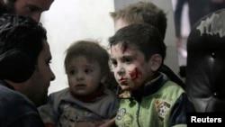 Injured children rest in a field hospital in the Duma neighborhood of Damascus, Jan. 21, 2015.