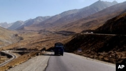 In this Wednesday, Sept. 23, 2009. Troubled highway is seen near Pol-I-Kumari, Afghanistan, along the one time Silk Road route.