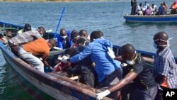 Rescuers retrieve a body from the water near Ukara Island, in Lake Victoria, Tanzania, Sept. 21, 2018, after the passenger ferry MV Nyerere capsized.
