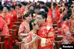 Alibaba employees attend a mass wedding at their headquarters in Hangzhou, Zhejiang province, May 10, 2017.