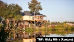 A typical home by the bayou, built high on stilts to protect from flooding in southern Louisiana, Nov. 15, 2017.
