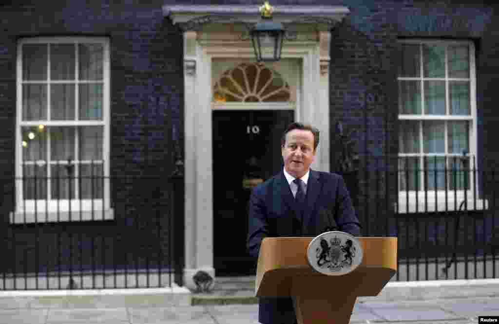 Britain's Prime Minister David Cameron speaks to members of the media in front of 10 Downing Street in London, Sept. 19, 2014.