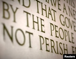 FILE - A line from Abraham Lincoln's Gettysburg Address is displayed at the Lincoln Memorial in Washington.