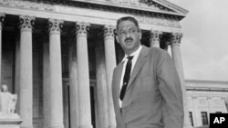 FILE - This Aug. 22, 1958 file photo shows Thurgood Marshall outside the Supreme Court in Washington.