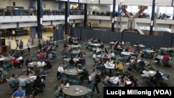 Students eat and study in one of several dining halls at the Brigham Young University campus in Provo, Utah.