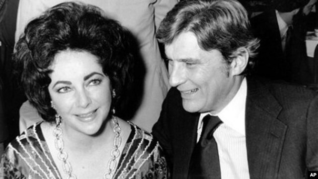 Actress Elizabeth Taylor and her husband, former secretary of the U.S. Navy John Warner, at the 42nd New York Film Critics Circle Awards dinner in New York, Jan. 30, 1977
