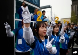 Supporters of the main opposition party, the Minjoo Party of Korea, cheer for their candidates during a campaign rally ahead of the April 13 parliamentary election in Seoul, South Korea, Tuesday, April 12, 2016.