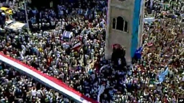 An image taken from footage uploaded on YouTube shows hundreds of thousands of Syrian anti-government protesters flooding the streets of the central city of Hama, July 1, 2011