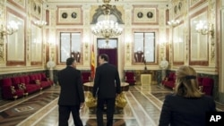 Spain's Prime Minister Mariano Rajoy, center, leaves after a debate on the 2013 budget spending cuts at the Spanish Parliament in Madrid, Tuesday Oct. 23, 2012. The government has introduced austerity measures and financial and labor reforms in a bid to c