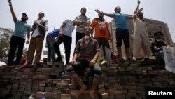 Sledbenici Muslimanskog bratstva i zbačenog predsednika Mohameda Morsija u jednom predgradju Kaira