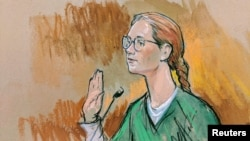 In this courtroom sketch, accused Russian agent Maria Butina pleads guilty to a single conspiracy charge in a deal with prosecutors and admitted to working with a top Russian official to infiltrate a powerful gun-rights group and influence U.S. policy toward Moscow.