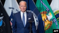 Joe Biden leaves after addressing the Intelligence Community