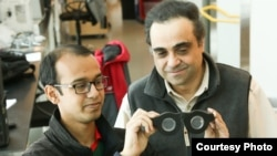 """University of Utah electrical and computer engineering professor Carlos Mastrangelo, right, and doctoral student Nazmul Hasan have created """"smart glasses"""" with liquid-based lenses that can automatically adjust the focus on what a person is seeing, whether it is far away or close up. (Credit: Dan Hixson/University of Utah College of Engineering)"""