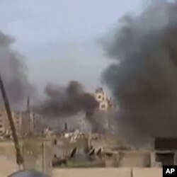 An image grab taken from a video uploaded on YouTube on February 6, 2012 shows what was described as shelling on the Baba Amr district of the restive city of Homs in central Syria.