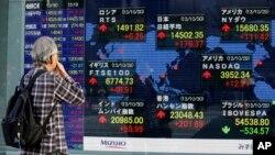 Indicadores de la bolsa de Tokio. La economía mundial crece menos de lo esperado.