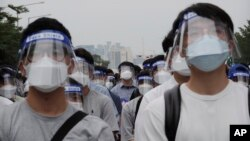 Interns and resident doctors attend a rally against the government medical policy in Seoul, South Korea.