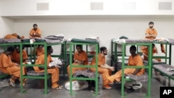Inmates hang out on their bunks in the Harris County Jail in Houston, Texas.