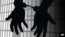 Hands bound by handcuffs