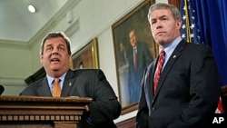 New Jersey Governor Chris Christie (l) nominates Attorney General Jeffrey Chiesa to temporarily fill the U.S. Senate seat that opened up after Senator Frank Lautenberg's death, June 6, 2013, in Trenton, New Jersey.