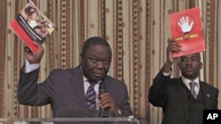 FILE: Zimbabwe Prime Minister and Movement For Democratic Change (MDC) leader Morgan Tsvangirai (L) and National Organising Secretary Nelson Chamisa present a booklet at the launch of Conditions for a Sustainable Election in Zimbabwe (COSEZ) in Harare, March 8