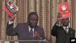 FILE: Former Zimbabwe Prime Minister and Movement For Democratic Change (MDC) leader Morgan Tsvangirai (L) and then National Organising Secretary Nelson Chamisa present a booklet at the launch of Conditions for a Sustainable Election in Zimbabwe (COSEZ) in Harare, March 8